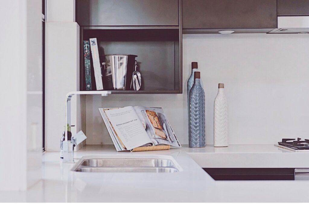 A picture containing indoor, wall, sink, counter  Description automatically generated