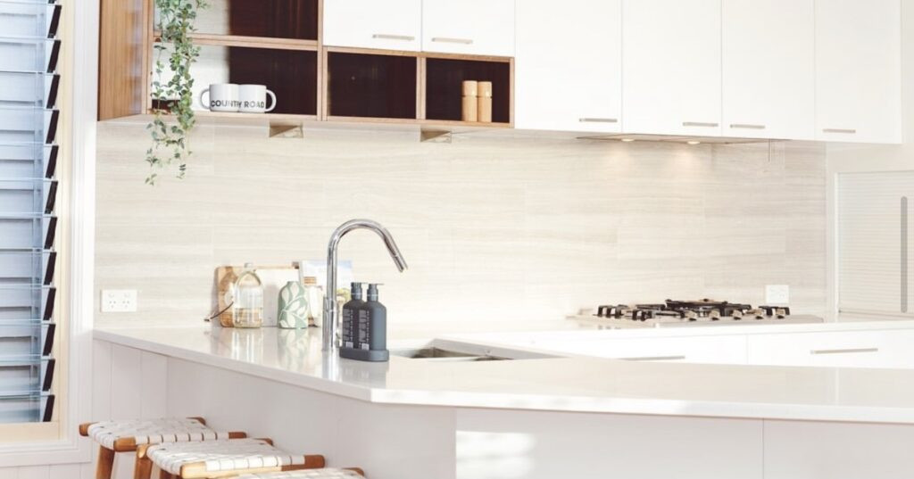 A picture containing indoor, window, sink, counter  Description automatically generated